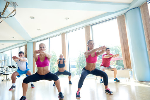 group of young people working out in a fitness gym
